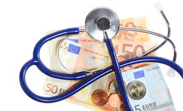 Cost of health care: stethoscope on euro money Stock Photos