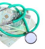 Cost of health care: stethoscope on polish money Stock Photos