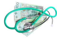 Cost of health care: stethoscope on polish money Royalty Free Stock Photo