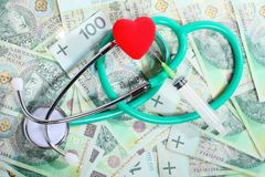 Cost of health care: stethoscope red heart polish money Stock Images