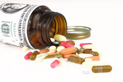 Cost of Healthcare. Pills come out from a medicine bottle Royalty Free Stock Images
