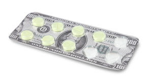 Cost of Healthcare. Pills in a money blister package Royalty Free Stock Photography