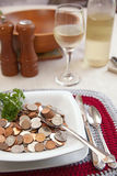 Cost of living with spoonful vertical. A visual depiction of the cost of living using Canadian coins in place of food. here a spoon of money is in the bowl stock photo