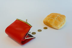 The cost of a loaf of bread. A purse containing cents to buy a loaf of bread Stock Photography