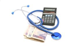 Cost of medication. Stethoscope with money isolated on white and calculator stock photos