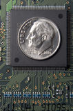 Cost of memory. Dime on transistor Stock Image