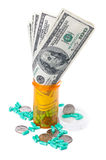 The cost of prescriptions. The high cost of prescriptions in a pill bottle Stock Photography