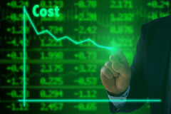 Cost reduction on green stock wall Stock Photo