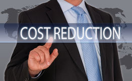 Cost Reduction - Manager with touchscreen. World map in the background stock photos