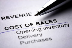 Cost of Sales. Macro photograph of a financial report - focusing on cost of sales and revenue Stock Photos
