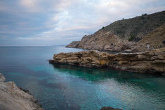 Costa Blanca nudist beach. Conill, one of the most popular nudist beaches on Costa Blanca, Spain, amidst scenic rocky landscape Stock Images