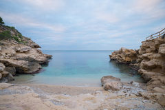 Costa Blanca nudist beach. Conill, one of the most popular nudist beaches on Costa Blanca, Spain, amidst scenic rocky landscape Royalty Free Stock Photos