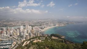 Costa Blanca town with blue sea and apartments Calpe Spain Levante beach. Costa Blanca town with blue sea and apartments Calpe Spain Levante La Fossa beach stock video footage