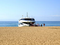 Costa Brava Ferry at Malgrat de Mar, Spain. The coastal ferry to Tossa de Mar boarding at Malgrat de Mar, Costa Brava, Catalonia, Spain Stock Image
