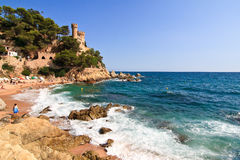 COSTA BRAVA, SPAIN, 2012:  beach with castle in the background Stock Image