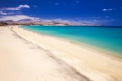 Costa Calma sandy beach with vulcanic mountains on Jandia peninsula, Fuerteventura island, Canary Islands, Spain. Stock Photo
