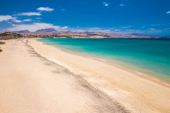 Costa Calma sandy beach with vulcanic mountains on Jandia peninsula,  Fuerteventura island, Canary Islands, Spain. Stock Images