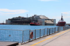 Costa Concordia, sea voyage and arrival at the port of Genoa Voltri stock photo