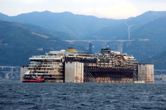 Costa Concordia, sea voyage and arrival at the port of Genoa Voltri Stock Photos