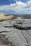 Costa costa del granito que erosiona Fotos de archivo