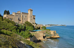 The Costa Daurada at Salou. A modern hotel with a pool is built as a fortress in the shore covered with lush foliage. The Costa Dorada is one of the most popular Royalty Free Stock Image