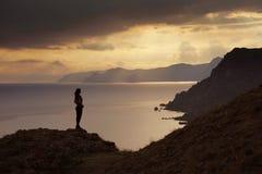 Costa costa de la puesta del sol foto de archivo