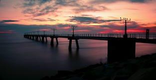 Costa de la puesta del sol Imágenes de archivo libres de regalías