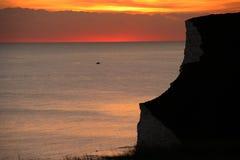 Costa de la puesta del sol Fotos de archivo libres de regalías