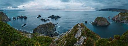 Costa de Loiba Asturias, Spain. Costa de Loiba sunset bad weather before thunderstorm landscape with rock formations near shore Asturias, Spain. Three shots stock image
