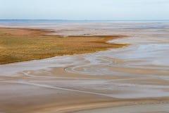Costa de mar con marea baja Imagenes de archivo