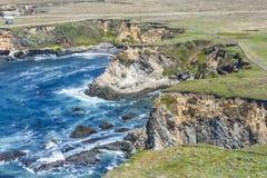 Costa del Pacifico selvaggia all'arena del punto fotografia stock