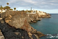 Costa del Silencio - high volcanic coast with rock formation. In the Silence Bay with clear turquoise water of the ocean Stock Photo