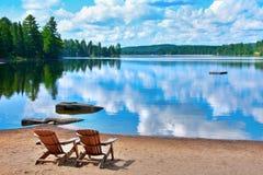 Costa do lago chairs Imagem de Stock Royalty Free