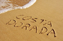 Costa Dorada written in the sand Stock Photos
