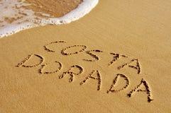 Costa Dorada written in the sand Stock Photos