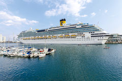 Costa Fascinosa in Savona Italy. Savona, Italy - September 27, 2015:cruise ship Costa Fascinosa leaves the port of Savona for a cruise in the Mediterranean, with Stock Photography