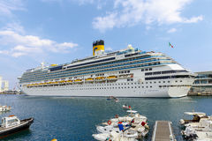 Costa Fascinosa in Savona Italy. Savona, Italy - September 27, 2015:cruise ship Costa Fascinosa leaves the port of Savona for a cruise in the Mediterranean, with Royalty Free Stock Photo