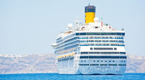 Costa Fortuna; anchored close to Santorini. Stock Photo