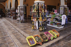 Costa Maya Mexico Shopping. Colorful Mexican arts and crafts, souvenirs, and tequila available for purchase by tourists at a store in Costa Maya, Mexico. A Royalty Free Stock Photo