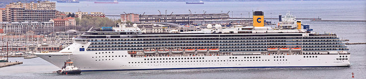 Costa Mediterranea leaves Trieste harbor at dawn, large panorama Royalty Free Stock Images