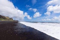 Costa preta da areia Fotografia de Stock