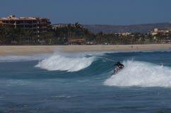 Costa que practica surf Azul Los Cabos México Imagen de archivo