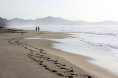 Costa Rei beach in Sardinia and a couple walking along it Stock Image