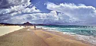 Costa Rei beach in Sardinia island. Wide panorama view of Costa Rei beach in a cloudy day stock images