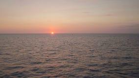 Costa Rica Aerial. V7 Flying low over ocean towards sunset cresting horizon stock video