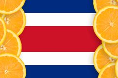 Costa Rica flag in citrus fruit slices vertical frame. Costa Rica flag in vertical frame of orange citrus fruit slices. Concept of growing as well as import and vector illustration