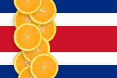 Costa Rica flag and citrus fruit slices vertical row stock photography
