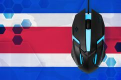 Costa Rica flag and computer mouse. Concept of country representing e-sports team. Costa Rica flag and modern backlit computer mouse. Concept of country royalty free stock image