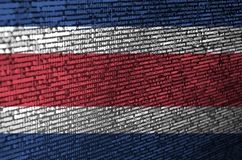 Costa Rica flag is depicted on the screen with the program code. The concept of modern technology and site development.  stock illustration