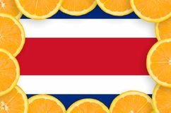 Costa Rica flag in fresh citrus fruit slices frame. Costa Rica flag in frame of orange citrus fruit slices. Concept of growing as well as import and export of royalty free illustration